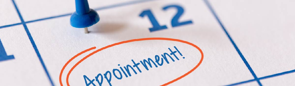 """calendar with blue pushpin and the word """"appointment"""" circled in red"""